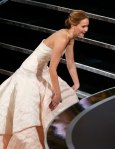 Jennifer Lawrence reacts after she fell walking up the steps to accept the award for best actress at the 85th Academy Awards in Hollywood
