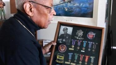 Alex and medals. (PRNewsFoto/Dynasty Media Network )