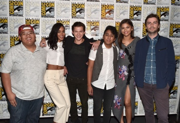 "SAN DIEGO, CA - JULY 23: (L-R) Actors Jacob Batalon, Laura Harrier, Tom Holland, Tony Revolori, Zendaya and director Jon Watts from Marvel Studios? ""Spider-Man: Homecoming? attend the San Diego Comic-Con International 2016 Marvel Panel in Hall H on July 23, 2016 in San Diego, California. ©Marvel Studios 2016. ©2016 CTMG. All Rights Reserved.  (Photo by Alberto E. Rodriguez/Getty Images for Disney)"